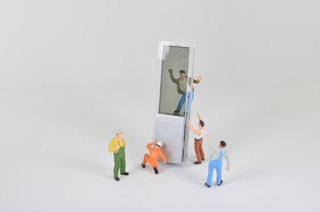 artisans: A group of tiny miniature artisans working together Stock Photo