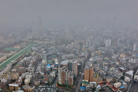 dense: Dense cityscape image of Tokyo urban landscape Ebisu Shibuya Editorial