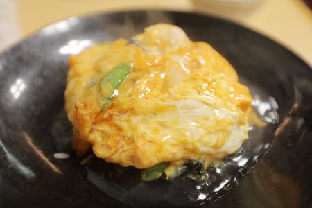 fired egg: plane steamed rice with deep fired egg on top.