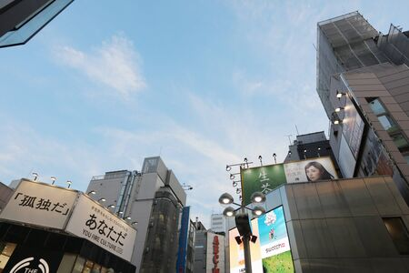 scramble: Street view of the famous Shibuya Crossing during daytime. Editorial