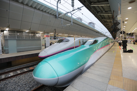 The green Series E5 Shinkansen trains