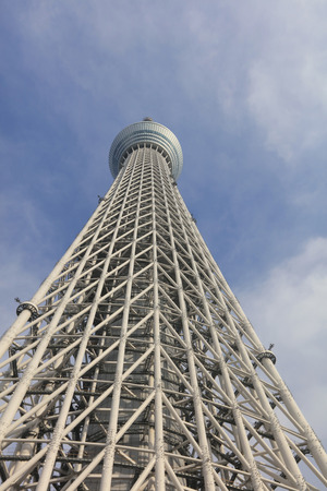 oshiage: Tokyo sky tree with airplane trail in the sky.