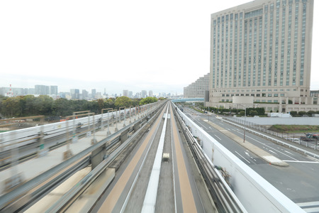 monorail: the Motion blurred monorail moving in Tokyo city