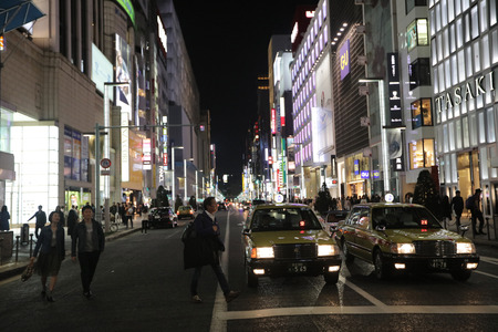 Ginza shopping district at rush hour in Tokyo.