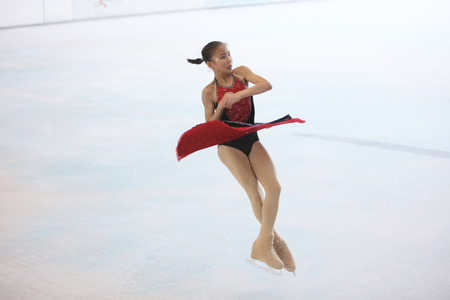 the  young skater performs on the ice 新聞圖片