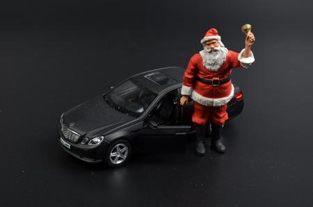 christmas figure, santa claus with car Stock Photo