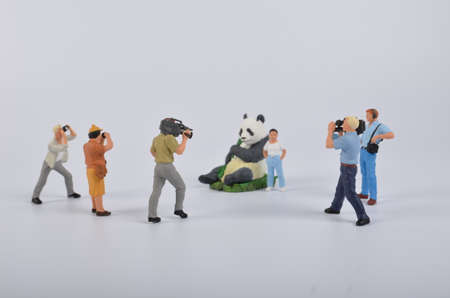 journalistic: the Plastic toy figurines. the TV Camera and Operator