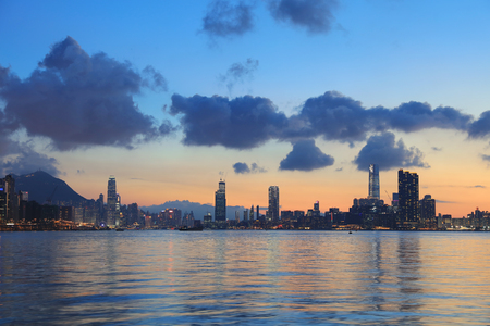 cityspace: Crowded downtown and building in Hong Kong at sunset