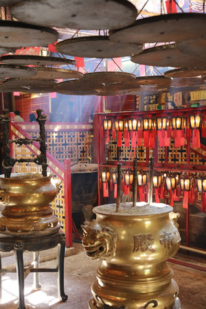 coils: with incense offerings and coils suspended from the ceiling. Editorial