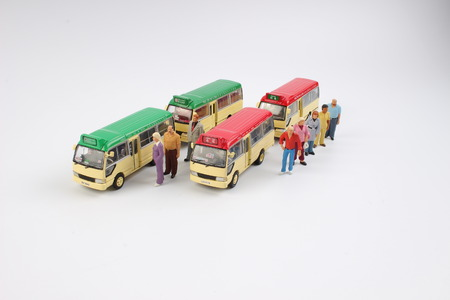 the Miniature people at a bus station