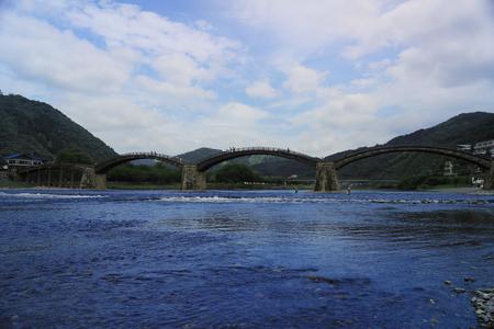 historical reflections: Kintai Bridge Arch bridge and Reflection Iwakuni Cityscape