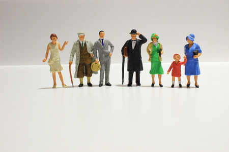 Toy, miniature figures of human in costumes, view from above Stock Photo