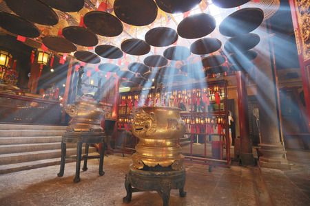 offerings: Interior of Man Mo Temple in Hong Kong with incense offerings Editorial