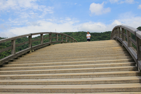 river scape: the Historic Kintaikyo Bridge in Iwakuni, Japan Editorial
