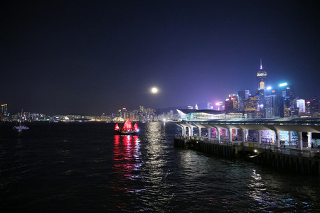 victoria harbor: full moon with HK at night from across Victoria Harbor Stock Photo