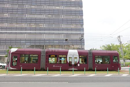 honshu: the  People ride public Hiroden tram in Hiroshima,