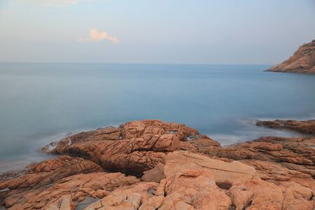 rocky sea coast and blurred water in shek o,hong kong Stock Photo