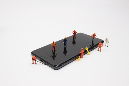 miniature people: Miniature people in engineer or worker occupation isolate