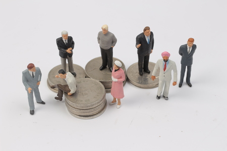 miniature people: the group of Miniature people on coins Stock Photo