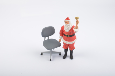 the Santa Clauses figure with a chiar