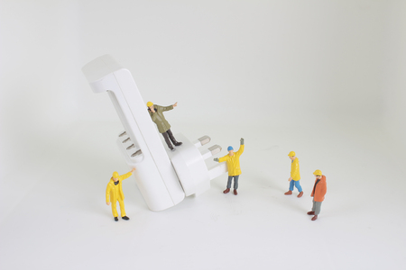the Miniature people in engineer or worker occupation isolate Stock Photo
