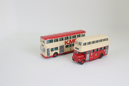 omnibus: the bright red traditional bus isolated over white
