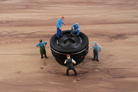 tiny lenses: the miniature woker clearing the lens