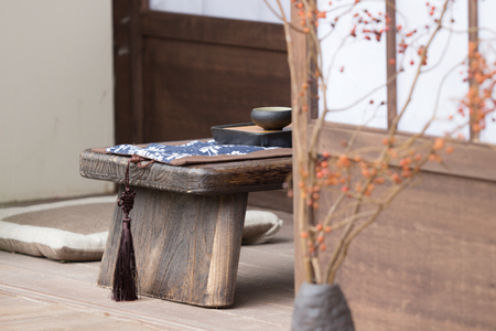 the peaceful zen rock garden with papyrus plant Stock Photo - 76369922