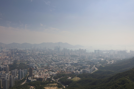 icc: Top view from The lion rock park,  Kowloon and Hong kong sky.