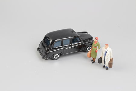 tiny of toy taxi with the traveler figure Stock Photo