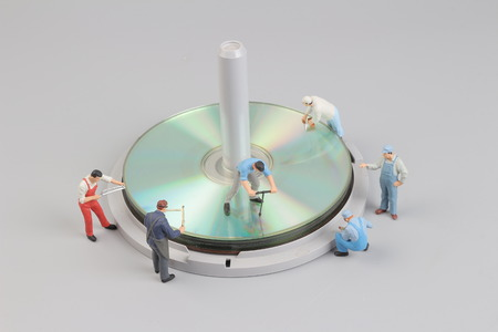 the mini figure of the worker around the disk