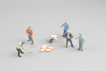 healthcare costs: the worker figure in front of the pills Stock Photo