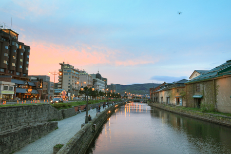 warehouse building: the Reflection of The Old Warehouse along Otaru Canal,