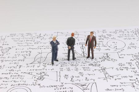 the Tiny figure stands near math formula