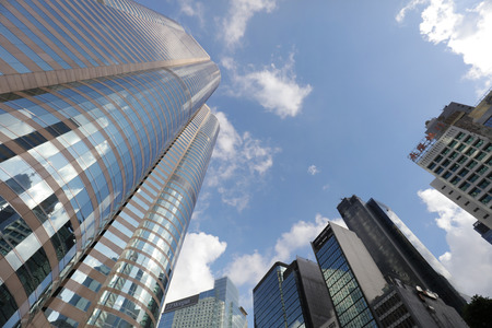 the street of highrise glass skyscraper buildings low angle