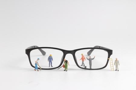 the Mini technician repairing reading of glasses