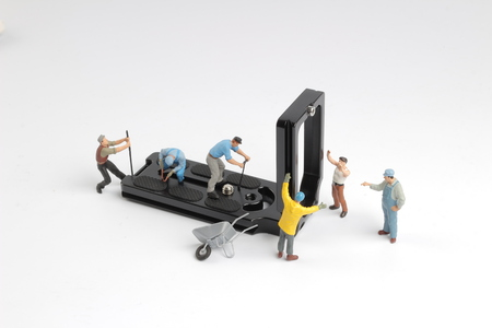 the group of small min figure repairing the tool Stock Photo