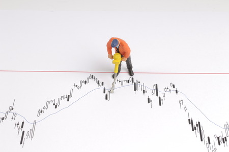 the Min worker with pickaxe working on a graph