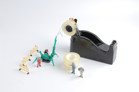 the tiny of worker replace the tape for dispenser Stock Photo