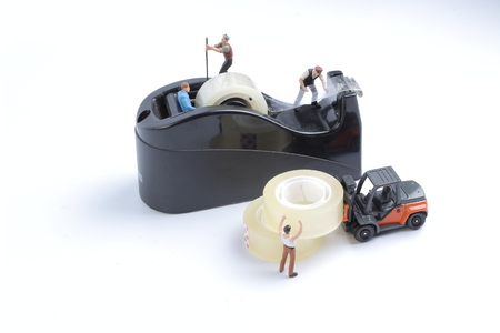the mini of worker replace the tape for dispenser Stock Photo