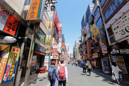 pedestrians at Kabuki-cho district in Shinjuku, Tokyo Japan.