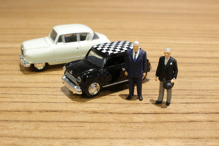 the min figures of a people and car Stock Photo