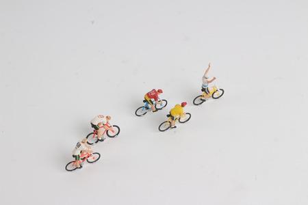 the min  figure of man ride bicycle on board 版權商用圖片