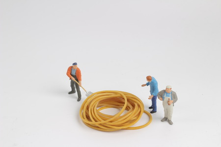the worker move the Rubber band at the board 版權商用圖片