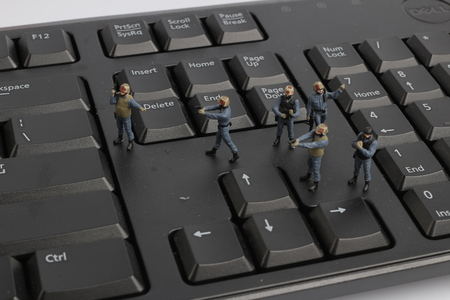 the mini swat team is guarding a laptop from viruses Stock Photo