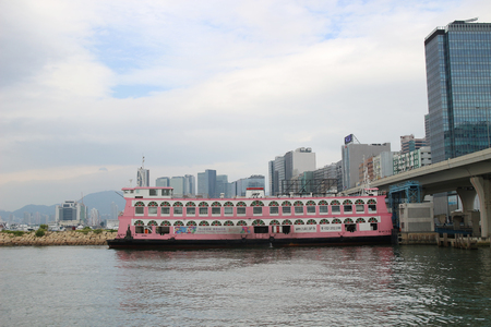 a car ferry sailing between hk and kowloon