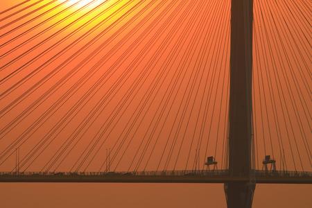 the sun set of the Ting Kau Bridge Imagens