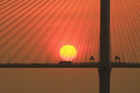 the sun set of the Ting Kau Bridge Editorial