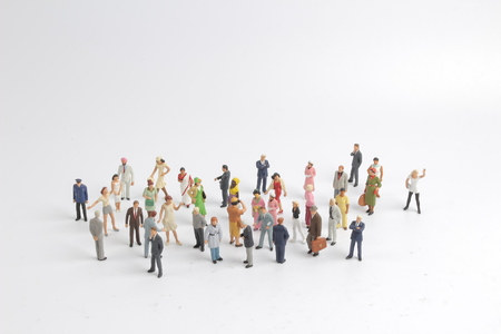 A collection of small miniature people on white background