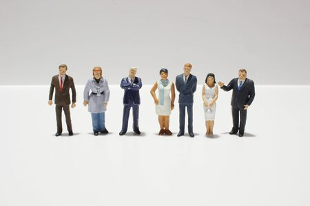 Mini figures of business on a white back ground